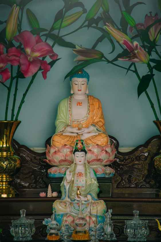 two buddha figurines